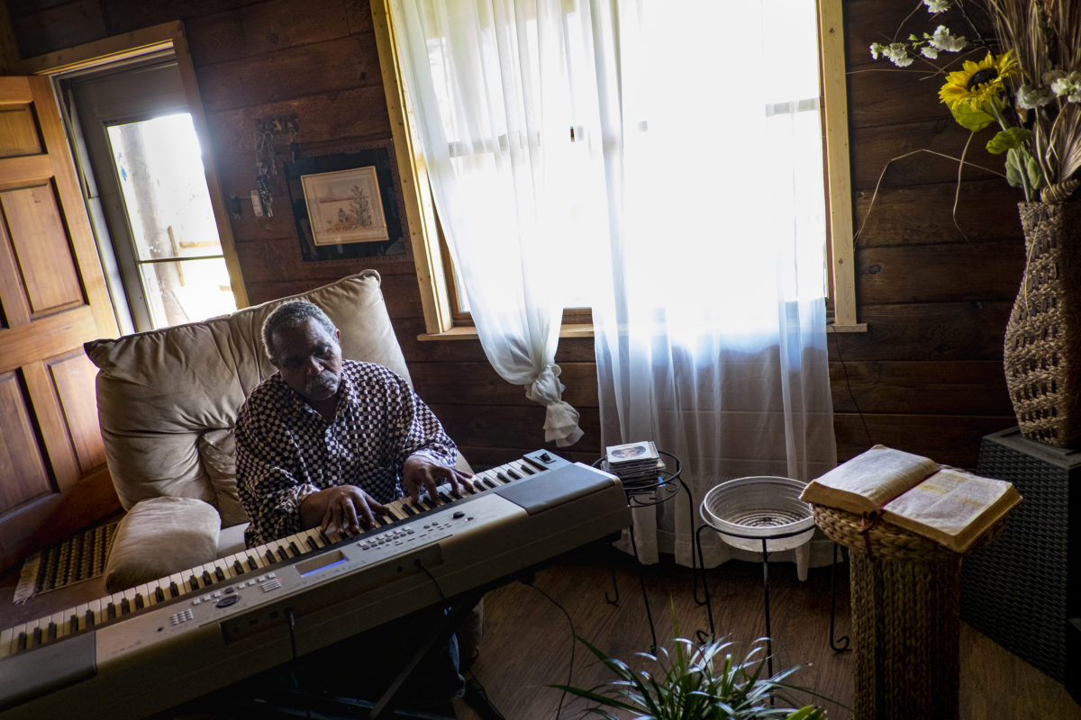 """Donald """"Amzi"""" Lightner, 63, plays music in his home in Clairton, Pa."""