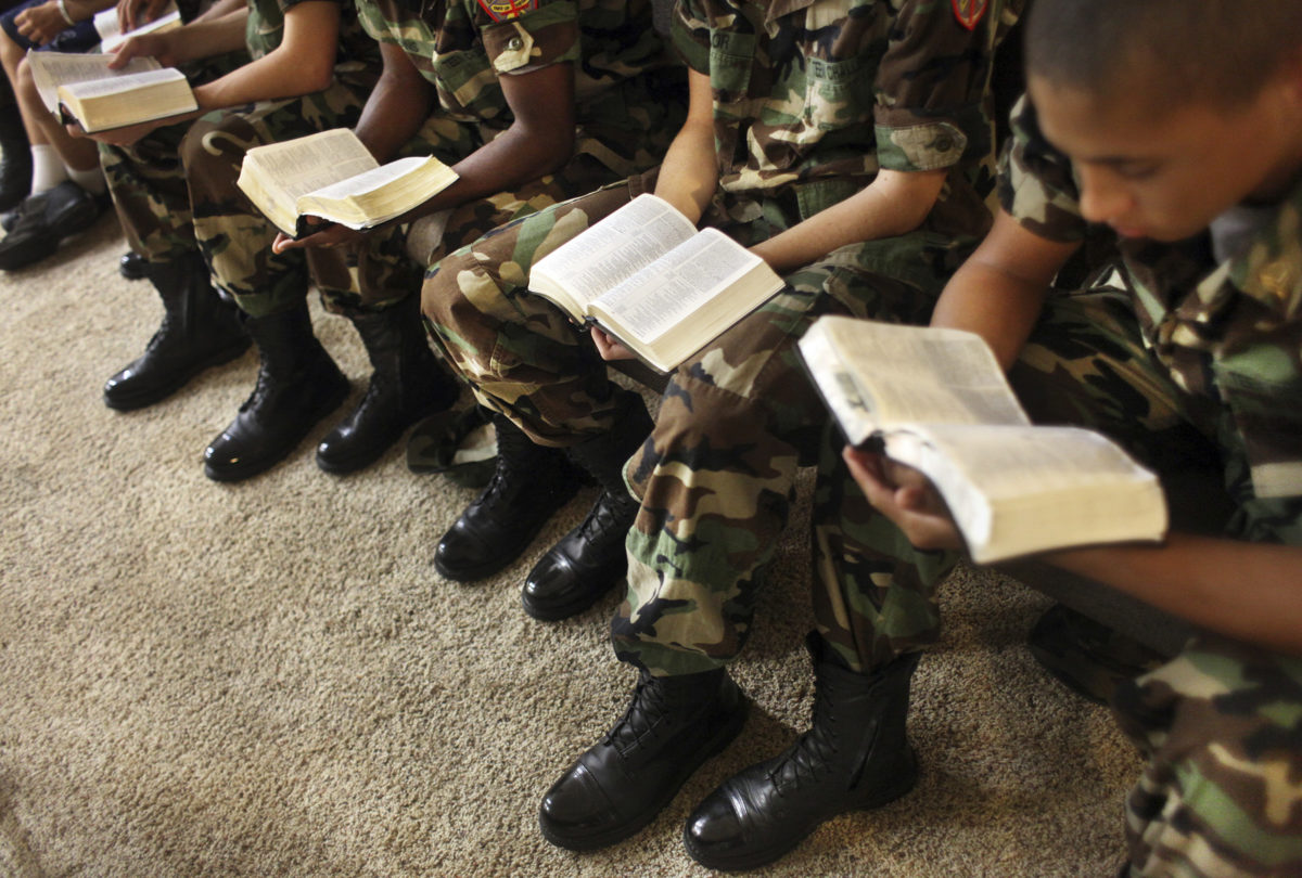Boys read from their Bibles during a church service in Bonifay, Florida.